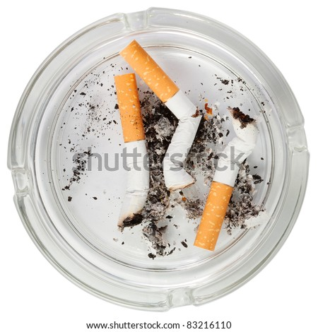 Glass ashtray with stubs . Isolated over white background . - stock photo