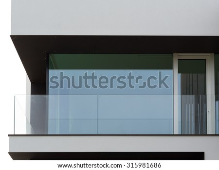 Glass balcony of modern house, close up view - stock photo