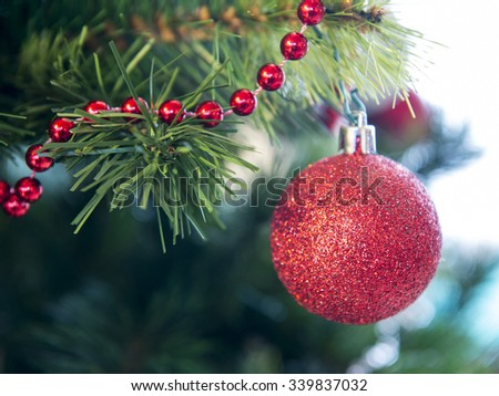 glass ball and decorations on Christmas tree