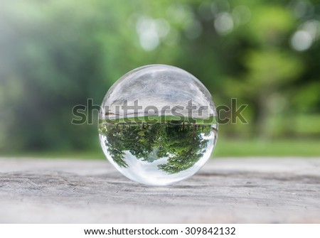 Glass ball on nature bokeh  background - stock photo