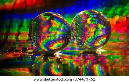 Glass balls on colorful background - stock photo