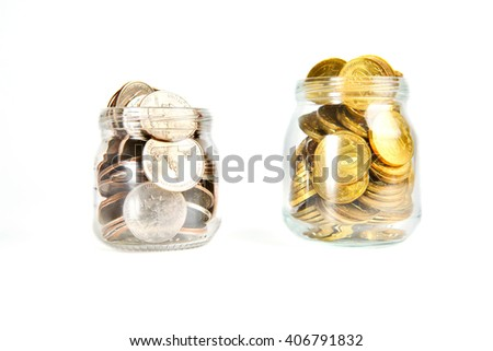 Glass bank for tips with money isolated on white. Russian and American coins. Ruble and dollars, cent - stock photo