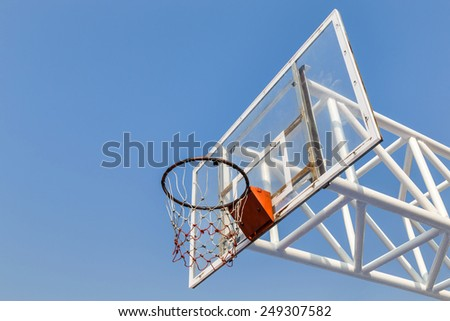 glass basketball board with  hoop on blue sky background - stock photo