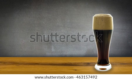 glass beer on wooden table with blackboard