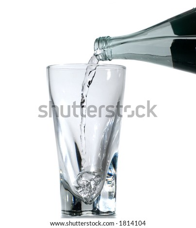 Glass being filled with water isolated on white - stock photo