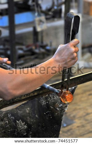 glass blower at work - stock photo