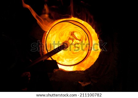Glass blowing process  - stock photo