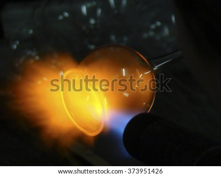 Glass blowing process. Glass-blowing workshop. Christmas decoration handmade, manufacturer of glass. Glassblowing. Close-up. Melting glass. - stock photo