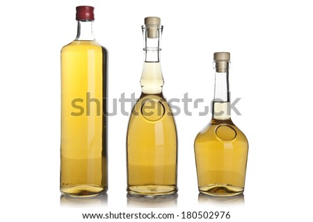 Glass bottle of brandy - stock photo