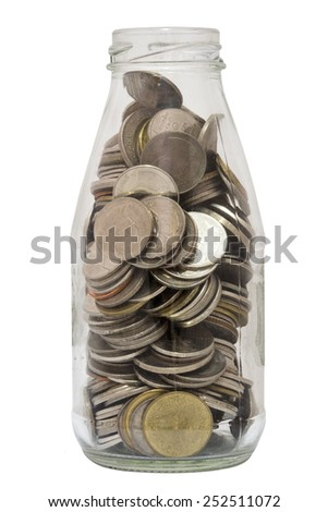 Glass bottle of coins isolated on white background - stock photo