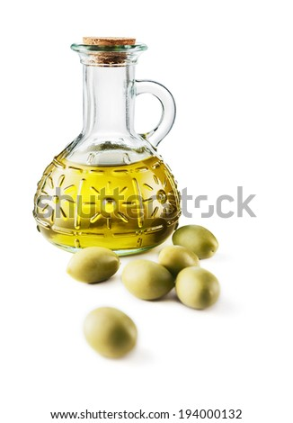 Glass bottle of premium virgin olive oil and some olives -Clipping Path