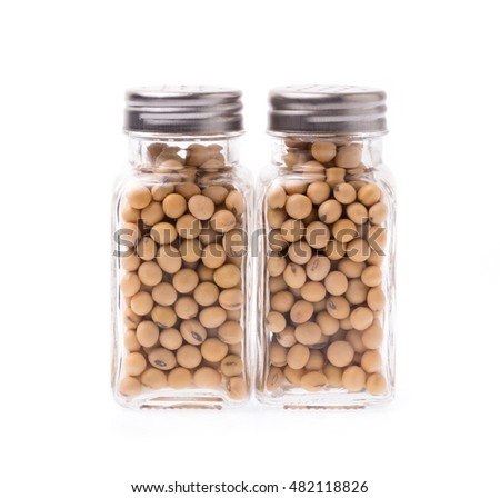 glass bottle of soybeans isolated on white background