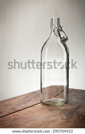 Glass bottle on a wooden table