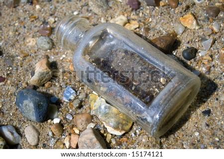 Glass Bottle on Beach - stock photo
