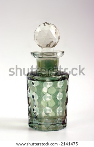 Glass bottle with empty white tag - stock photo