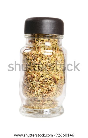 Glass bottle with oregano on white background