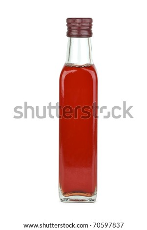 Glass bottle with red wine vinegar  isolated on the white background