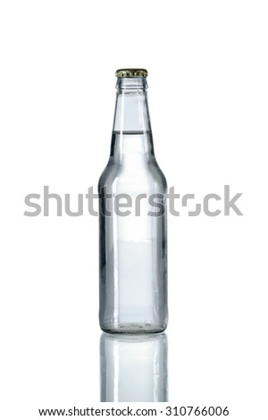 Glass bottled water on reflective table isolated over white background - With clipping path on bottle - stock photo