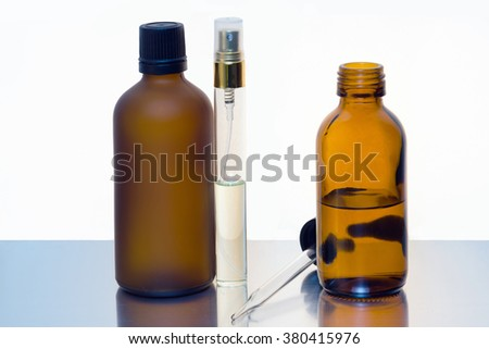 Glass bottles for cosmetic products with white background