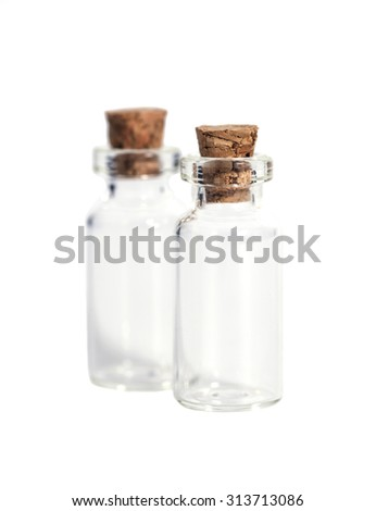 Glass bottles with cork cover isolated on white - stock photo
