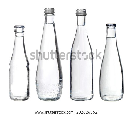 glass bottles with water isolated on white  - stock photo