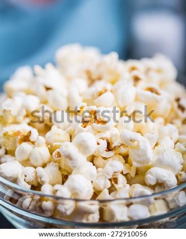 Glass bowl full of fresh popcorn. studio shot - stock photo