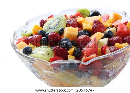 Glass bowl of luscious fresh fruit salad.