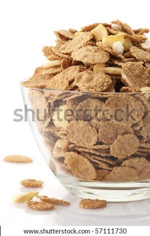 Glass bowl with breakfast cereal on white background. - stock photo