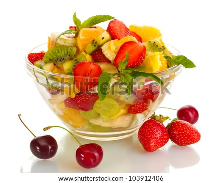 glass bowl with fresh fruits salad and berries isolated on white - stock photo