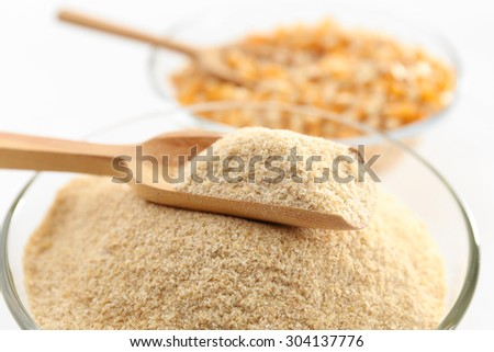 Glass bowls with flour and corn grains close up - stock photo
