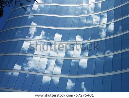 Glass building with cloud reflections - stock photo