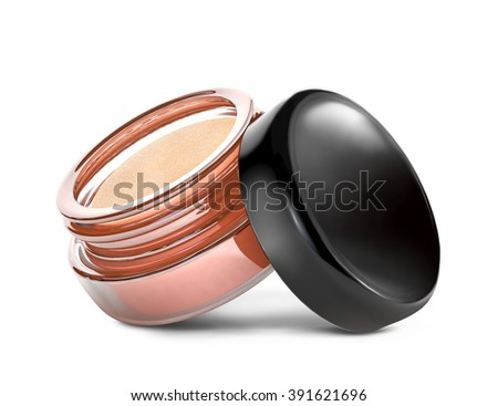 Glass can with golden eyeshadow  isolated over white background