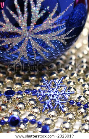 Glass celebratory sphere and snowflake of dark blue color on a background from a beads - stock photo