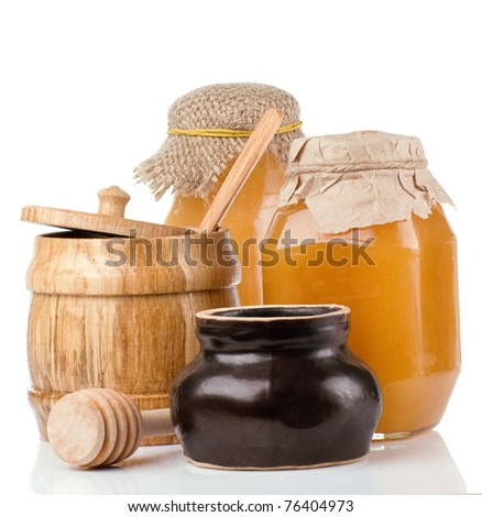 glass, ceramic and wooden jars full of honey isolated on white background - stock photo