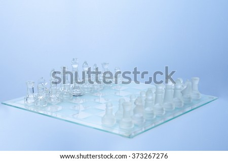 glass chess on the transparent chessboard
