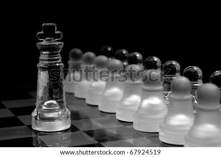glass  chess pawns in order ,against the king