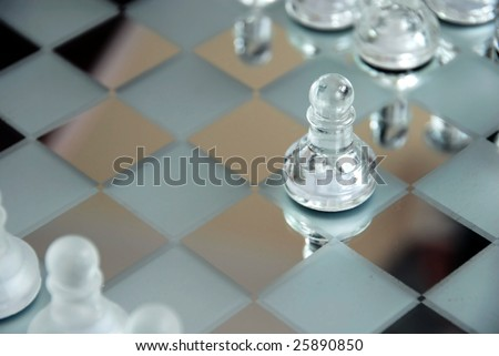 glass chessboard with first beginning position of pawn - stock photo
