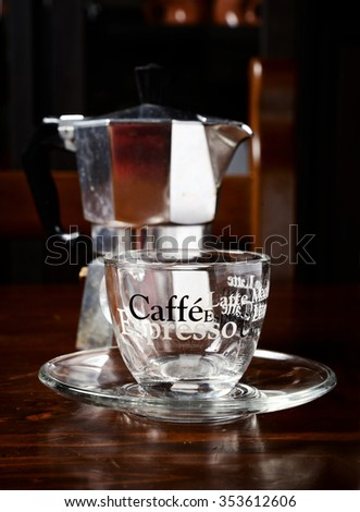 glass  coffee cup and  vintage coffeepot on dark wooden table - stock photo