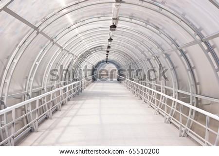 glass corridor in office centre - stock photo