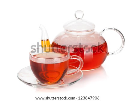 Glass cup and teapot of black tea. Isolated on white background - stock photo