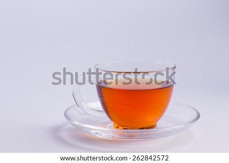 Glass cup of delicious black tea. - stock photo
