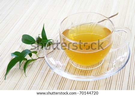 Glass Cup of Green Tea on Bamboo Napkin - stock photo