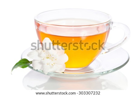 Glass cup of tea with jasmine on the white background - stock photo