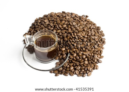 glass cup of turkish coffee with coffee beans around - stock photo