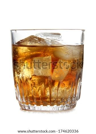 Glass cup of whiskey on white background - stock photo