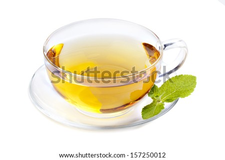 Glass cup tea with mint leaf, isolated on white - stock photo