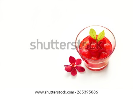 Glass delicious refreshing drink of vibrant watermelon on white background, blank text  - stock photo