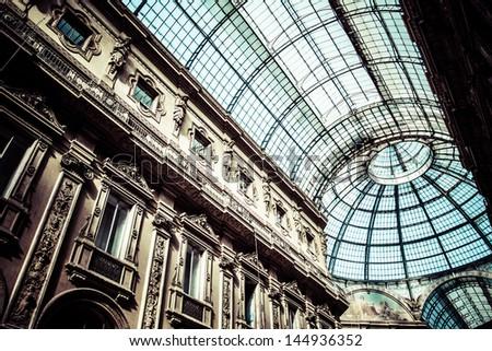 Glass dome of Galleria Vittorio Emanuele II shopping gallery. Milan, Italy. - stock photo