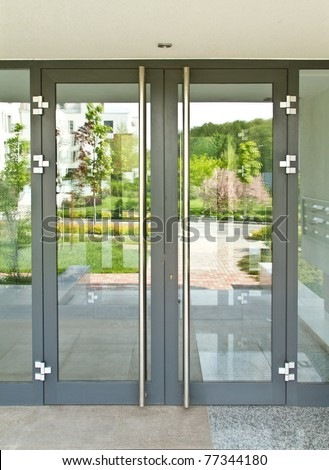 Glass door on a sunny day - stock photo