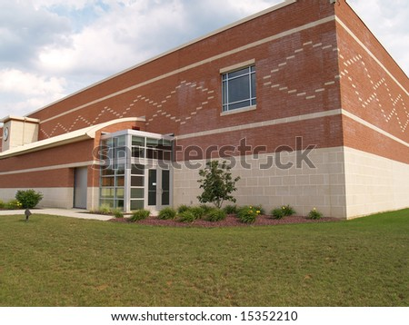glass doors entrance for a modern brick and block building - stock photo